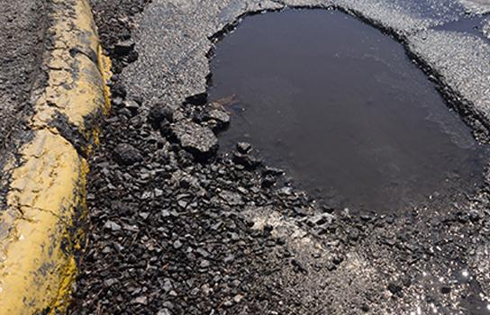 Potholes and Vehicle Damage - Join AAA today for peace of mind when you get a flat tire